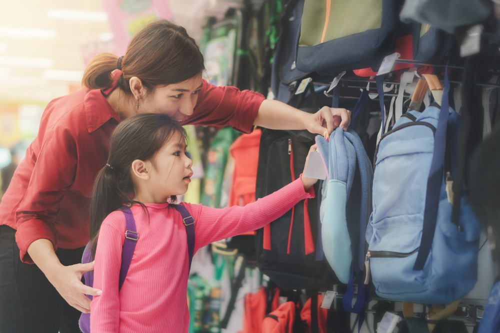 A mom and her daughter shop for backpacks for a new school year.