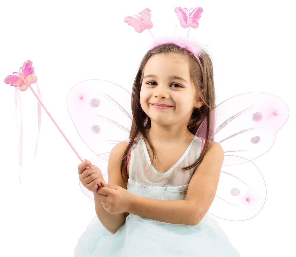 A little girl dressed as a fairy with wings, butterfly antennae and a butterfly wand.
