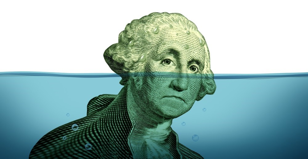 George Washington's head (from the dollar bill) is being encroached on by rising water; illustration on debt.